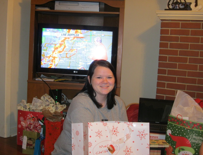 2012: My sister distributes presents while David Hartman spends Christmas Day doing severe weather break-ins.